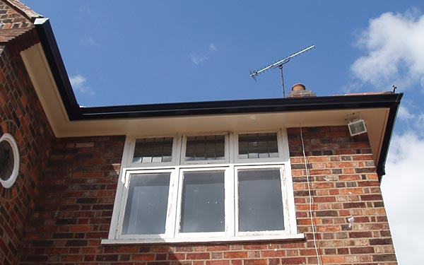 Black guttering with white fascias soffits